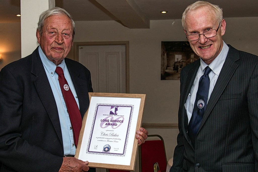 Chris Baker, left, receives his certificate from Peter Bell. Photo: Andy Jackson