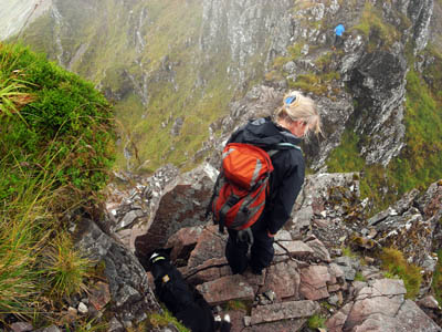 Heather and her rescue dog Milly look for the descent route from Aonach Eagach