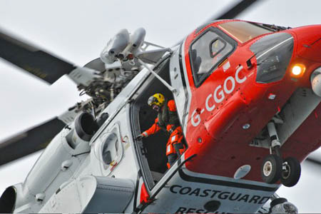 A Coastguard helicopter winched the two men from the mountain. Photo Robby Norman/Maritime and Coastguard Agency