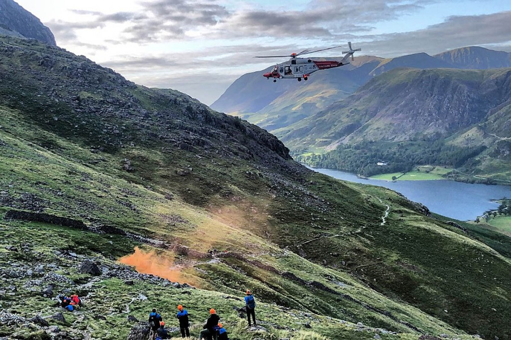 The scene on the hillside as the Coastguard helicopter approaches. Photo: Cockermouth MRT