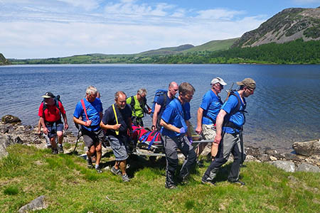 Cockermouth team members stretcher the walker from the Ennerdale Water shore. Photo: Ennerdale MRT
