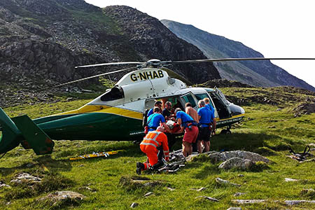 Mountain rescuers and air ambulance crew at the scene on Hay Stacks. Photo: Cockermouth MRT