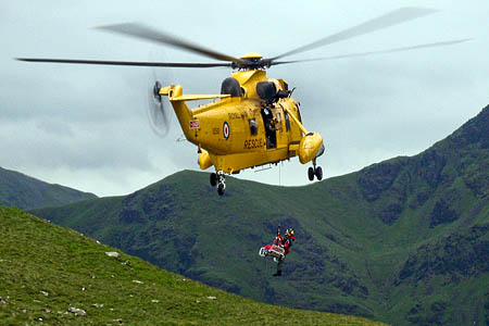 The woman is winched into the RAF Sea King after the rescue on High Crag. Photo: Cockermouth MRT