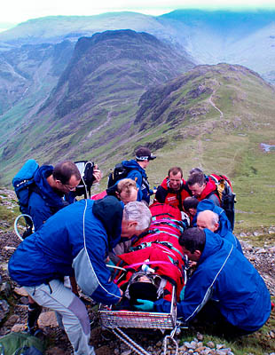 Rescuers with the injured walker on High Crag. Photo: Cockermouth MRT