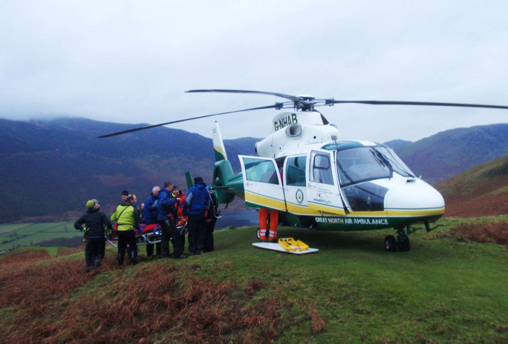 Rescue team members place the injured walker in the air ambulance. Photo: Cockermouth MRT