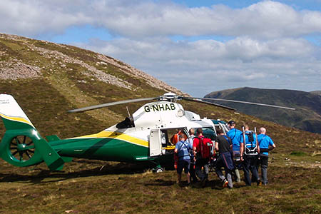 The walker is stretchered to the air ambulance. Photo: Cockermouth MRT
