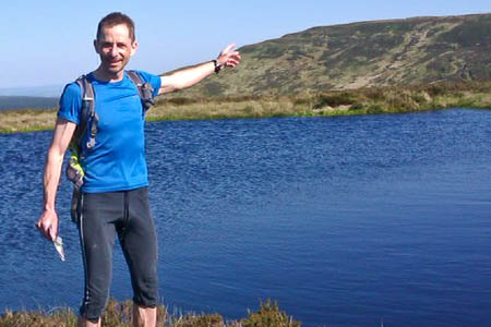 Colin Meek at the start of his challenge on the England-Scotland border