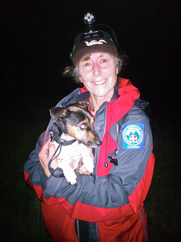Pip with a rescuer. Photo: Coniston MRT