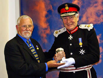 CRO member Roy Holmes receives the award from Lord Crathorne