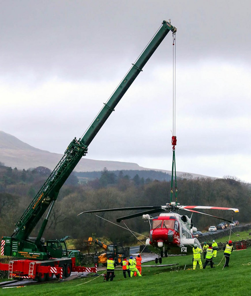 The Coastguard helicopter is craned on to a stable platform. Photo: CRO