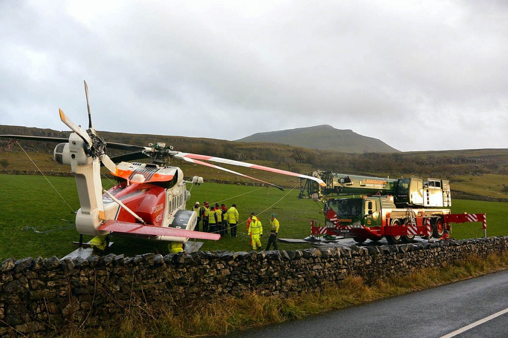 The stricken helicopter, with Ingleborough in the distance. Photo: Thomas Beresford