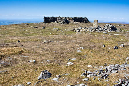 The cross shelter and trig point on Cross Fell's summit