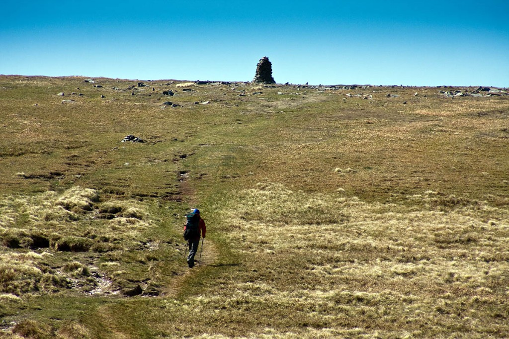 A walker heads for the highest point of the Pennine Way on Cross Fell