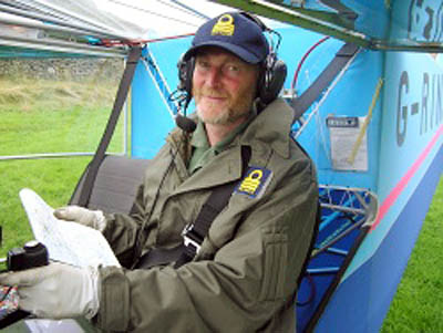 Mr Watt at the controls of one of his aircraft