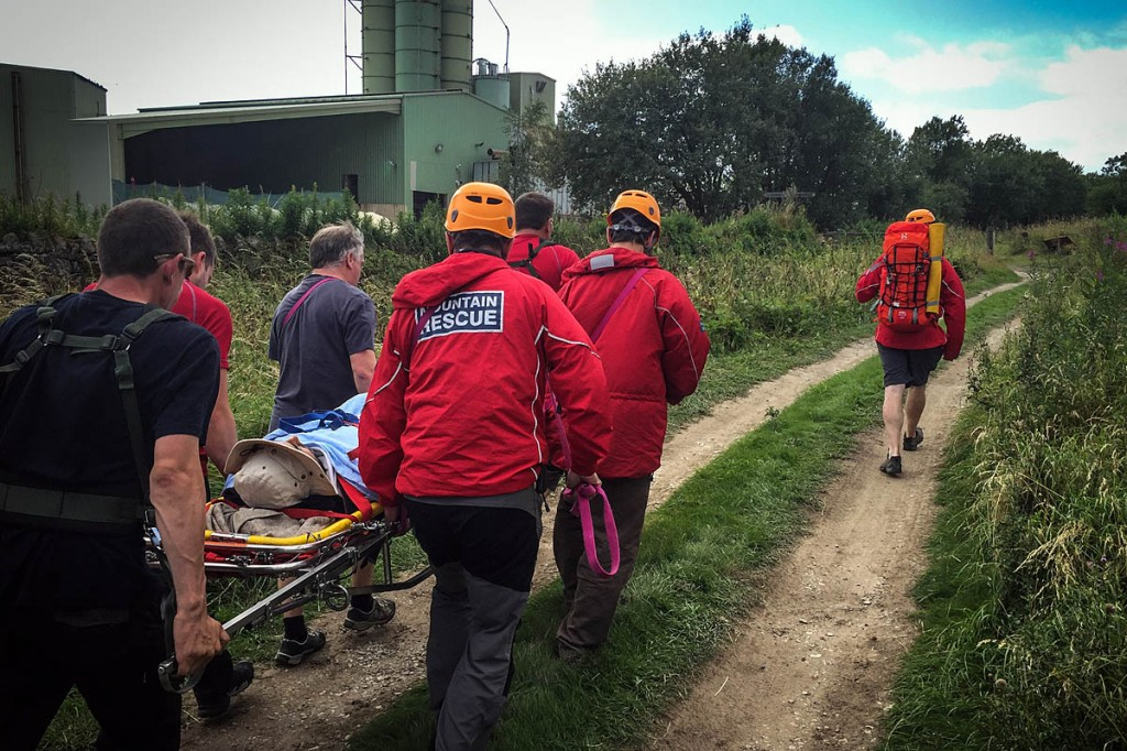 Rescuers stretcher the injured climber from the crag. Photo: Derby MRT