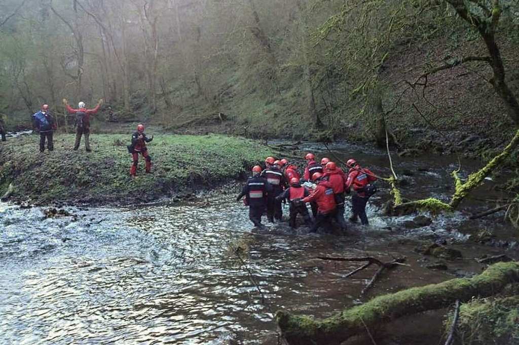 Rescuers stretcher the injured man to the island during the day's first incident. Photo: Edale MRT