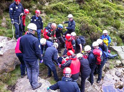 Rescuers at the scene in Crowden Clough