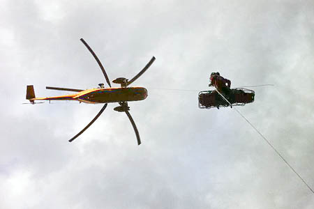 The walker is winched into the RAF Sea King