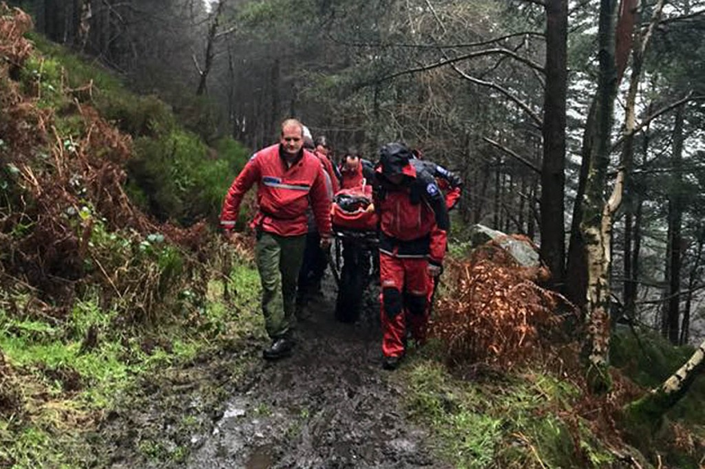 Rescue team members stretcher the injured rider from the woods. Photo: Edale MRT