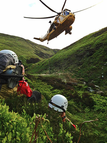Rescuers and the RAF Sea King at the Blackden Brook rescue. Photo: Edale MRT