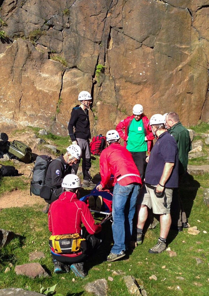 Team members at the site of the climbing fall at Lawrence Field. Photo: Edale MRT