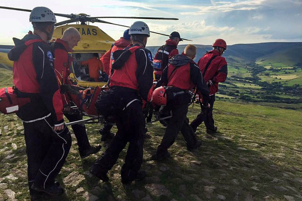 Rescuers stretcher the injured walker to the helicopter on Mam Tor. Photo: Edale MRT
