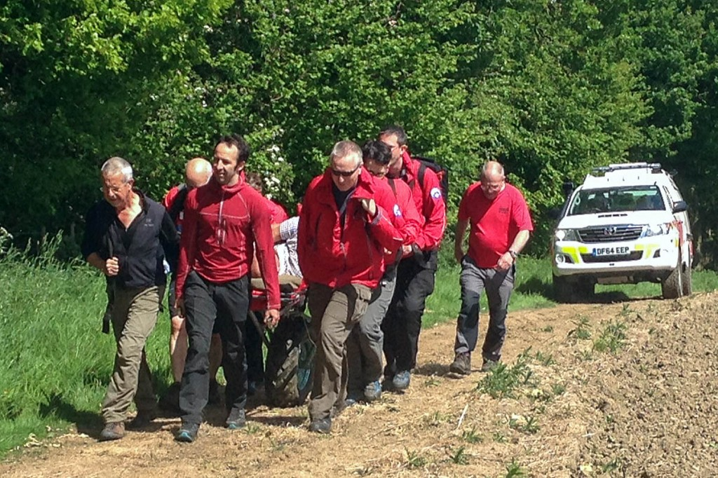 Rescuers stretcher the injured man from the site at Wigley. Photo: Edale MRT