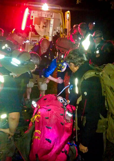 Rescuers with the walker injured in Grindsbrook. Photo: Jon Brook