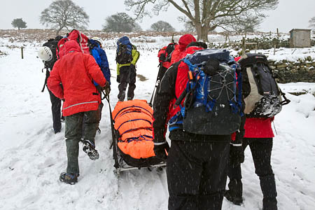 Edale Mountain Rescue Team 'sledges' the injured woman from the incident near Hathersage. Photo: Edale MRT