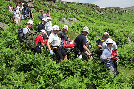 Rescuers stretcher one of the climbers from Stanage. Photo: Edale MRT
