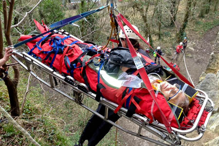 Rescuers lower the climber on the stretcher
