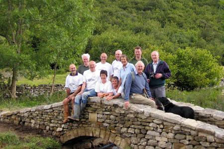 Members of the Dry Stone Walling Association and representatives from the national park authority and the CPRE on the completed bridge