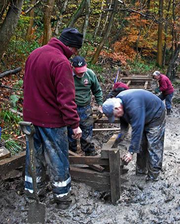 Volunteers at work building the boardwalk
