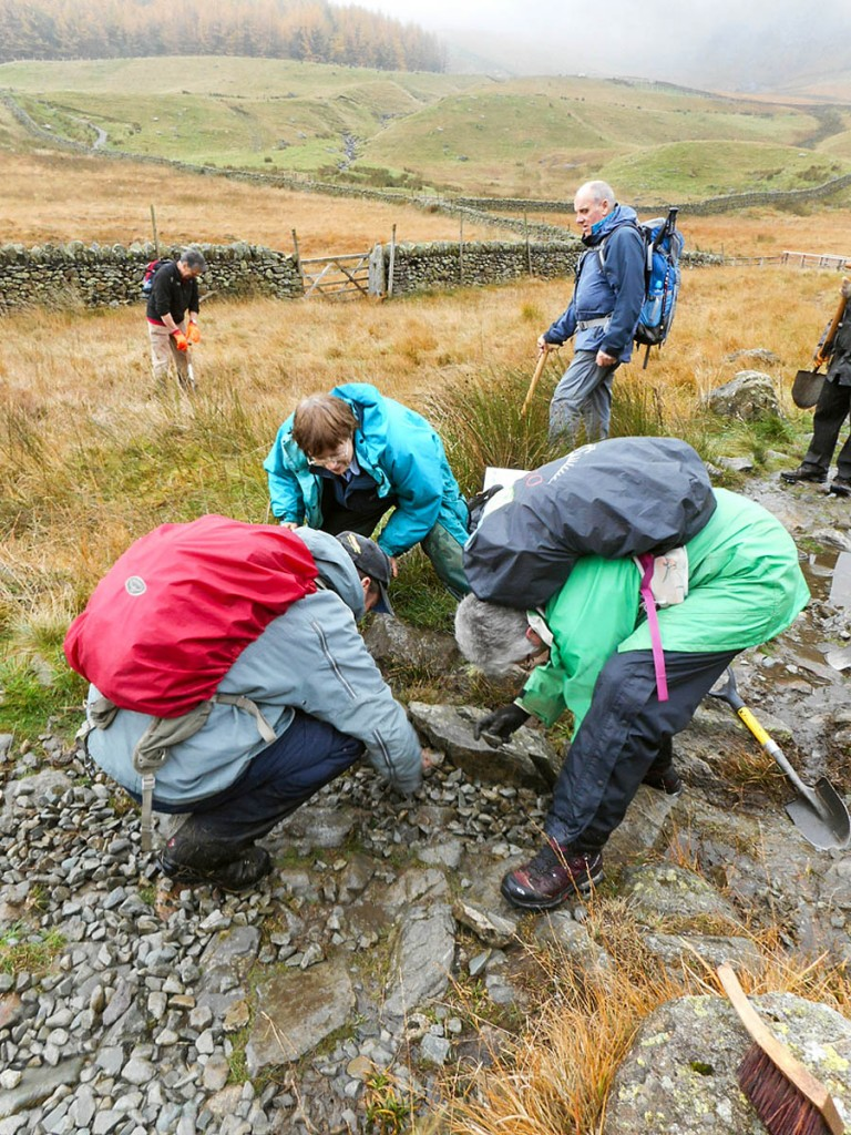 Volunteers work on repairing footpaths
