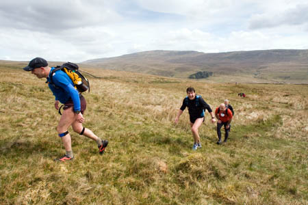 Competitors climb towards Gragareth, with Whernside behind them