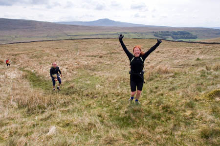 Still full of energy: one Fellsman hiker climbs from Kingsdale, with Ingleborough in the distance