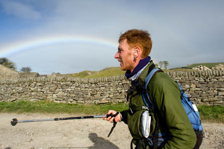 A Fellsman participant is greeted by a rainbow at Yarnbury