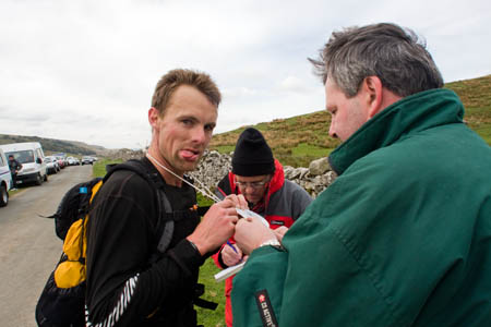 Checkpoint staff at Kingsdale clip a runner's tally