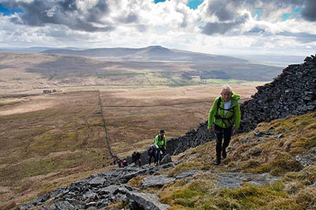 Fellsman competitors make the steep climb to Gragareth, with Ingleborough in the distance