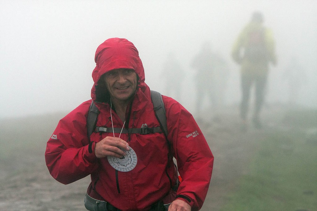 A Fellsman competitor arrives at Whernside summit