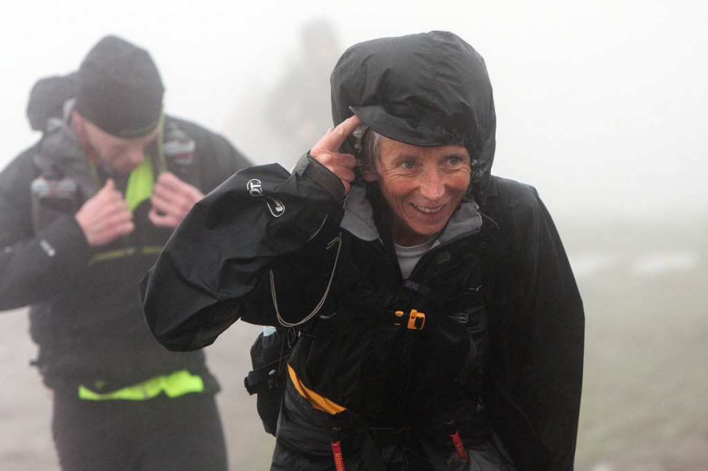 Tough conditions: Fellsman competitors arrive at Whernside summit