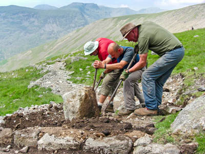 Fix the Fells volunteers at work with National Trust staff