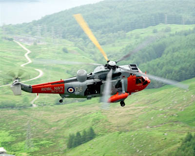 An HMS Gannet Sea King at work in the Scottish hills. Photo: Ian Arthur/Royal Navy