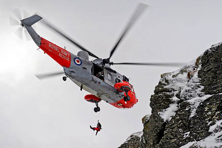 The crew of the Royal Navy Sea King had to winch casualties from two ridges