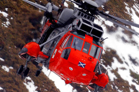 A Royal Navy Sea King helicopter airlifted rescuers to the rescue site and flew the injured climber to hospital