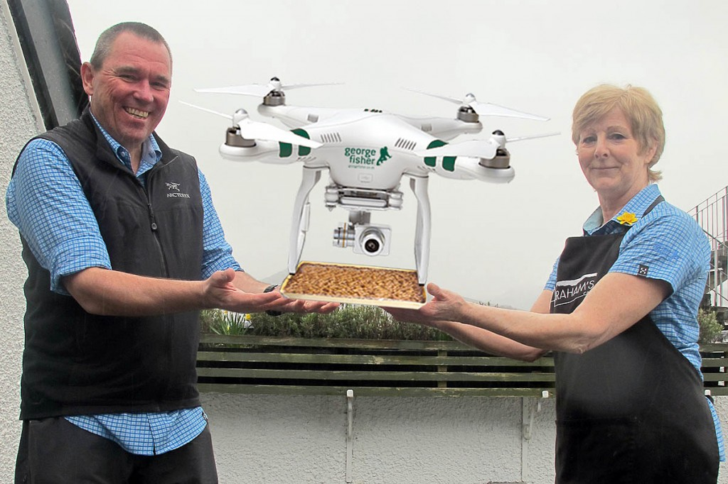 Andy Airey and Jan from Abrahams Cafe prepare the delivery drone