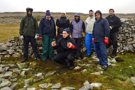 Sharing Voices Bradford out in the waterproofs dry stone walling on the Ingleborough national nature reserve