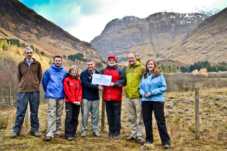 Glencoe property manager Scott McCombie, fourth from left, receives the cheque from HF Holidays chairman Brian Tilley, with NTS and HF Holidays staff