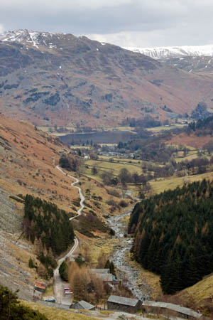 The valley of Glenridding, with the old mine buildings in the foreground and the village in the distance