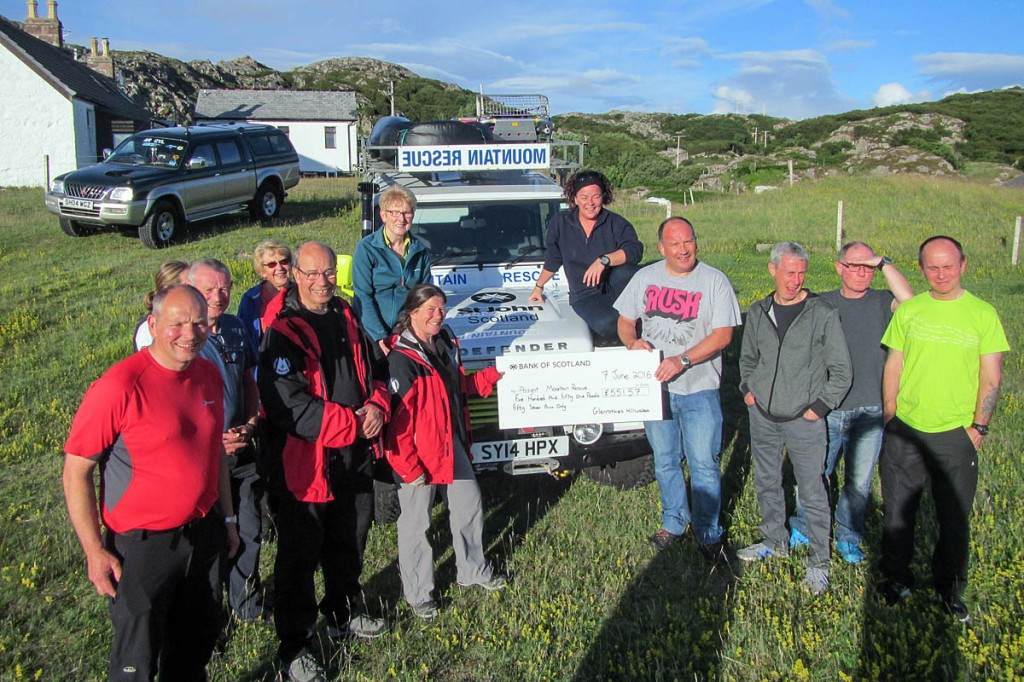 Members of Glenrothes Hillwalkers Club hand the cheque to Assynt Mountain Rescue